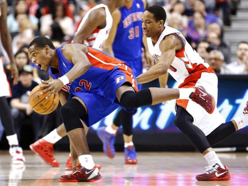 Detroit Piston's Khris Middleton goes to the basket against Toronto Raptors' DeMar DeRozan during the second half of their NBA basketball game in Toronto. Reuters