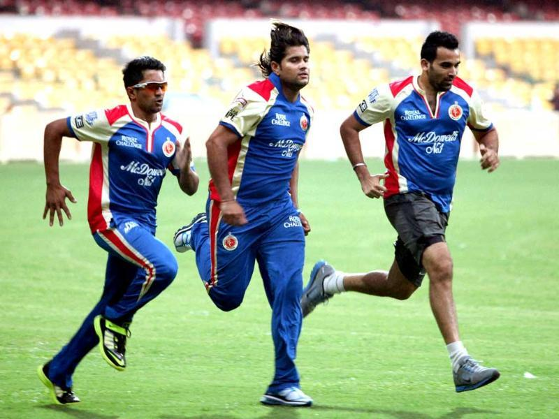 RCB players Zaheer Khan, Sourabh Tiwari and KP Apanna during a practice session at Chinnaswamy Stadium in Bengaluru. PTI Photo