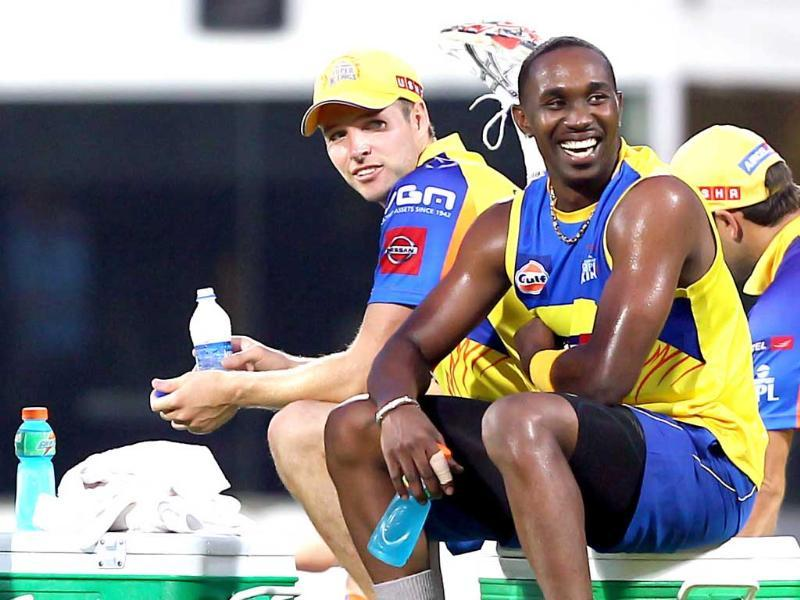 Chennai Super Kings players Dwayne Bravo and Jason Holder during a practice session in Chennai. PTI Photo