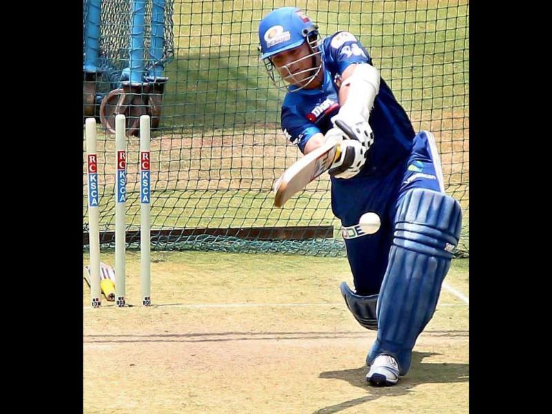 Mumbai Indians player Sachin Tendulkar bats during a practice session in Bengaluru ahead of the IPL matches. PTI Photo