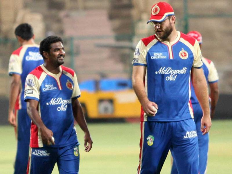 RCB players Daniel Vettori and Muthaiah Muralidharan during a practice session at Chinnaswamy Stadium in Bengaluru. PTI Photo