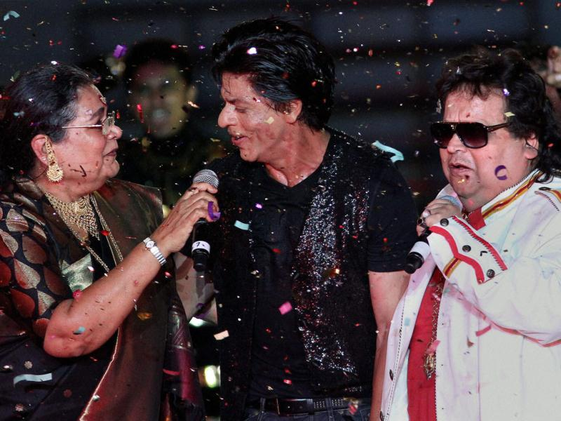 Shah Rukh Khan, Bappi Lahiri and Usha Uthup perform during the Pepsi Indian Premier League opening ceremony at the Salt Lake Stadium in Kolkata. (PTI Photo)