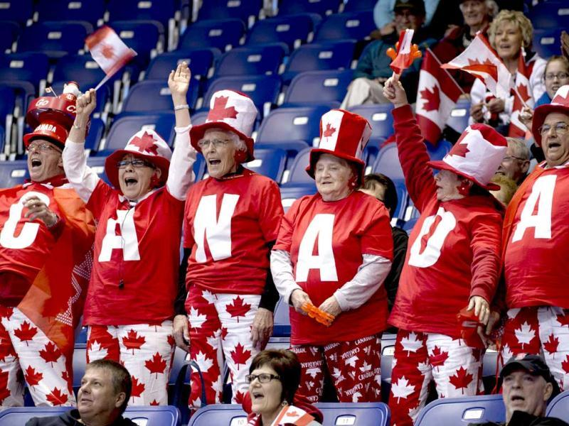 Canada curling fans cheer during an evening draw at the World Men's Curling Championships in Victoria, British Columbia. (AP)
