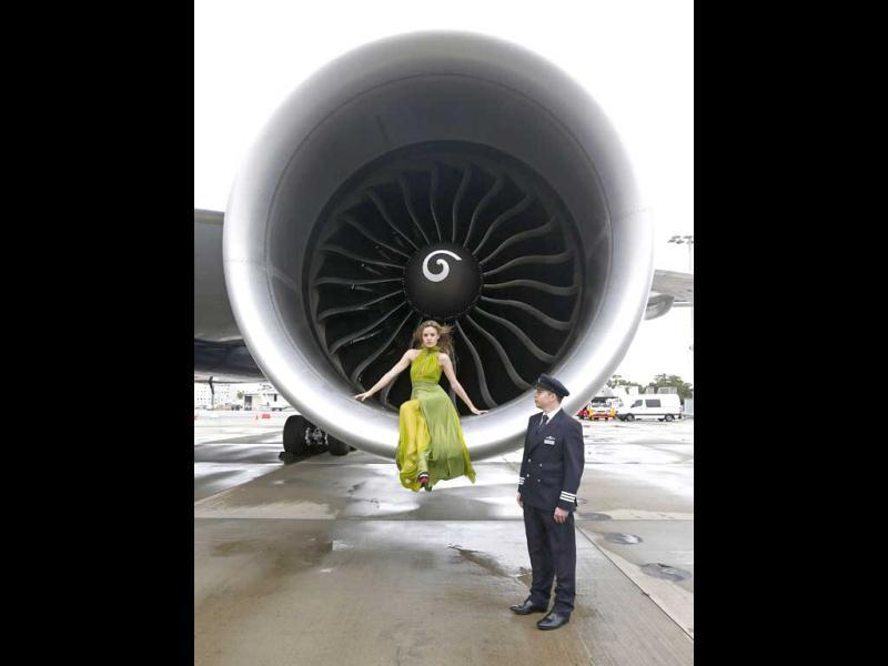 British model Georgia May Jagger poses for a picture in front of one of the turbine engines of a new British Airways 777-700ER aircraft at Sydney Airport. (Reuters)