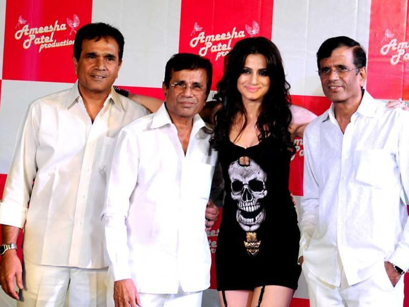 Indian Bollywood film directors Sultan (L) Abbas (C) and Mastan (R) pose with actress Ameesha Patel (2R) at the launch of the Hindi film Desi Magic directed by Mehul Atha in Mumbai late April 2, 2013. (AFP Photo)