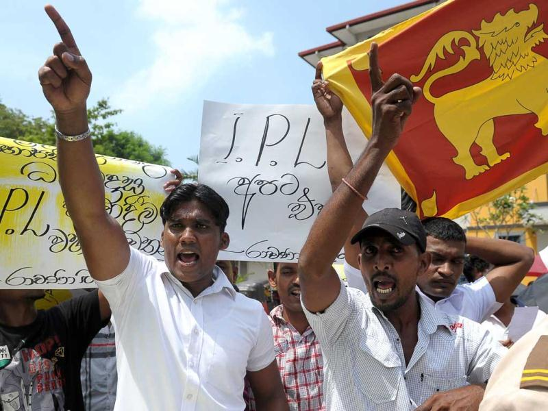 Sri Lankan activists of the Buddhist nationalist group 'Power of Ravana' shout slogans and wave placards as they stage a demonstration outside the Sri Lanka Cricket head office in Colombo. (AFP)
