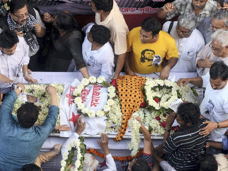People pay homage during funeral procession of SFI leader Sudipto Gupta, who allegedly died after a clash with Kolkata police in Kolkata. PTI Photo