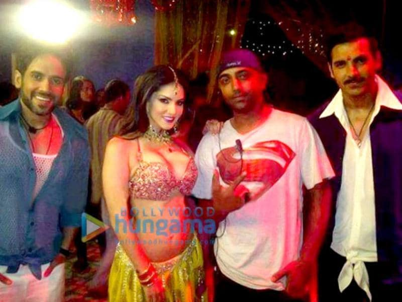 Sunny Leone poses on the sets of Shootout At Wadala with Tusshar Kapoor and John Abraham.