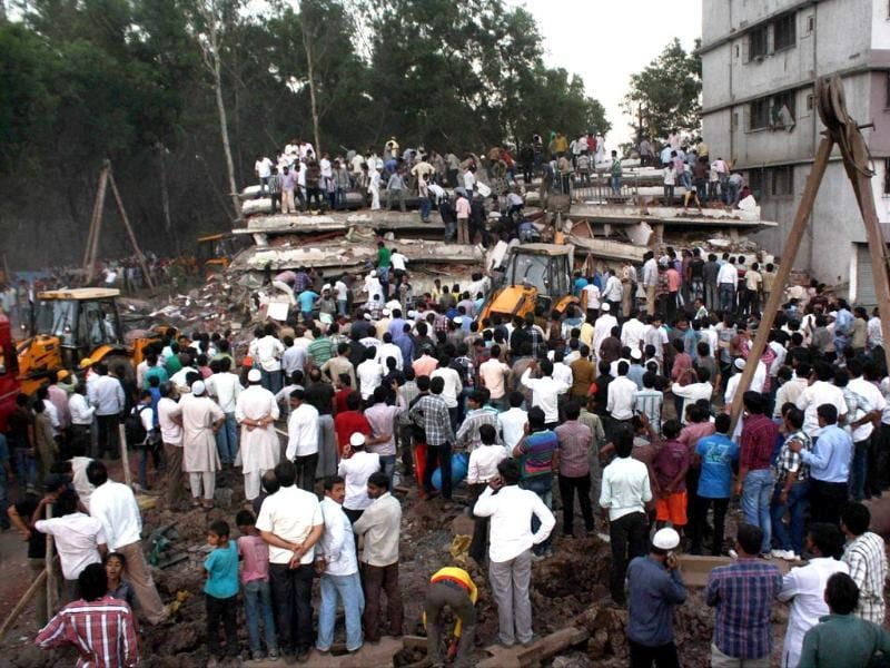 Fire brigade personnel rescue people from a building which collapsed in Thane. More than 10 persons, including a pregnant woman, were killed and twenty others injured when an under-construction building collapsed in Shil Phata area. PTI