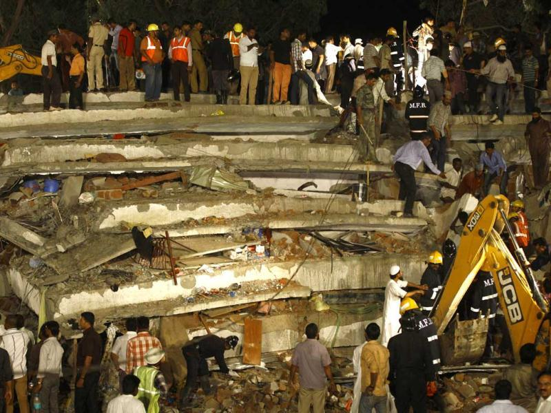 Rescue workers look for trapped people within the debris of the collapsed building in Thane that has claimed 30 lives till now. (AP)