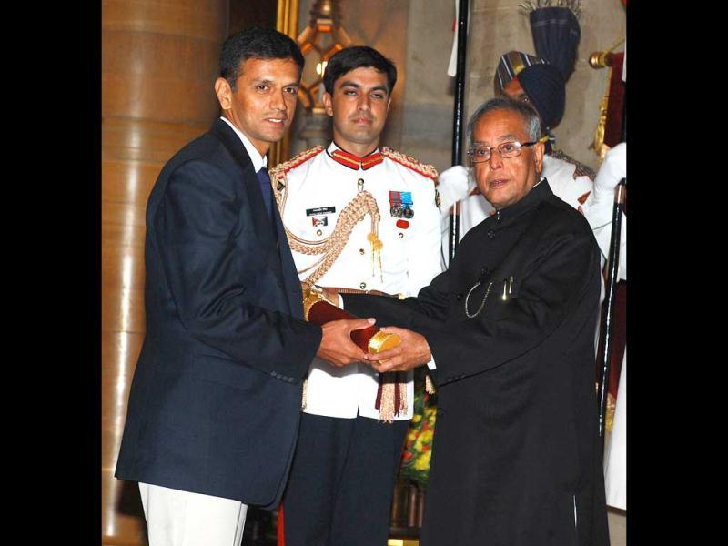 President Pranab Mukherjee (R) presents the Padma Bhushan award to former Indian cricket captain Rahul Dravid during the presentation of the Padma Awards 2013 at The Presidential Palace in New Delhi on April 5, 2013.(AFP Photo)
