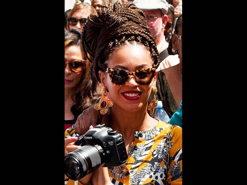 Capturing moments: Beyonce holds her camera as she tours Old Havana, Cuba. (AP Photo)