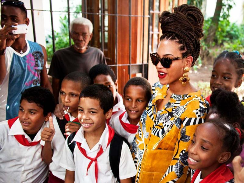 U.S. singer Beyonce poses for photos with school children as she tours Old Havana, Cuba, Thursday, April 4, 2013. Beyonce is in Havana with her husband, rapper Jay-Z, on their fifth wedding anniversary. (AP Photo)