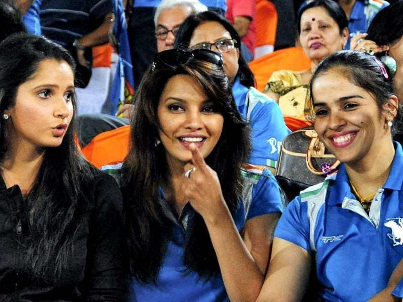 Tennis player Sania Mirza, actress Diana Hayden and badminton player Saina Nehwal talk during the during the IPL 6 match between Sunrisers Hyderabad's and Pune Warriors in Hyderabad. PTI