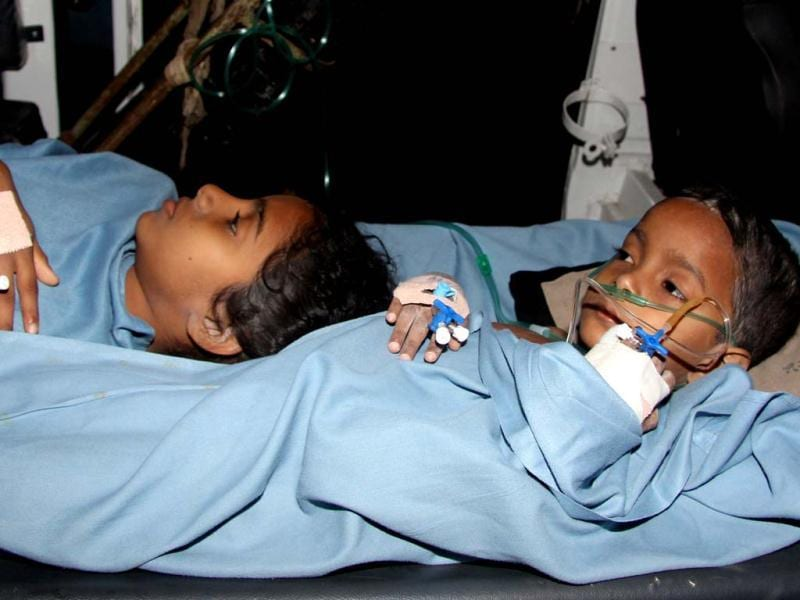Injured children who survived the building collapse in Thane, Mumbai. (HT Photo/Praful Gangurde)