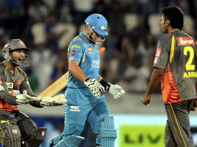 Sunrisers Hyderabad's wicketkeeper Parthiv Patel celebrates as Pune Warriors batsman Ross Taylor walks after his dismissal during the IPL 6 match in Hyderabad. PTI