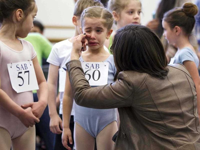 The mother of young ballet dancer Kyra Neamonitakis wipes a tear from her eyes before sending her into auditions for six-year-olds at the School of American Ballet (SAB) at Lincoln Center in New York. Reuters