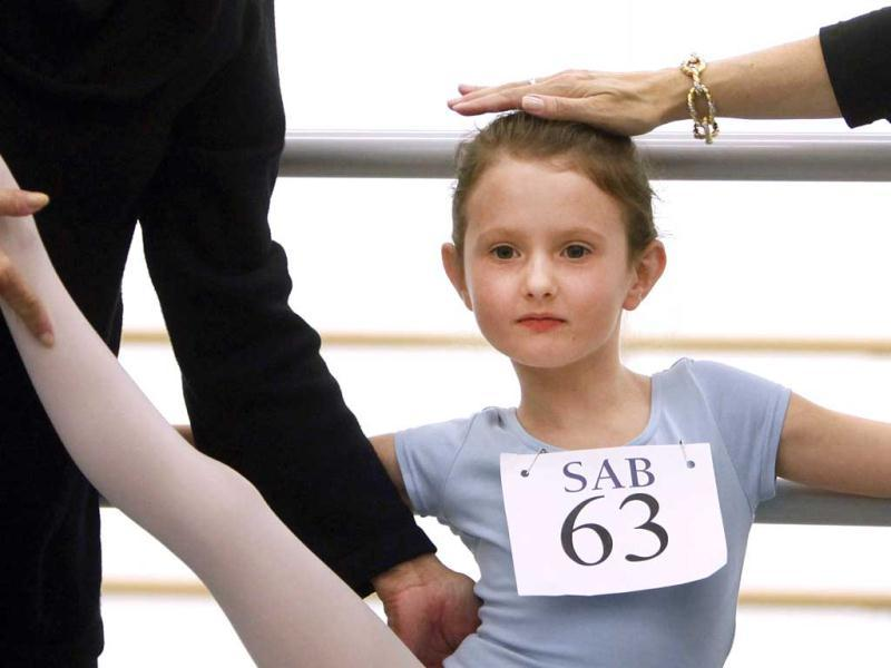 Natacha Ross, 6, of New York, is evaluated during an audition for six-year old ballet hopefuls at the School of American Ballet in New York. AP Photo