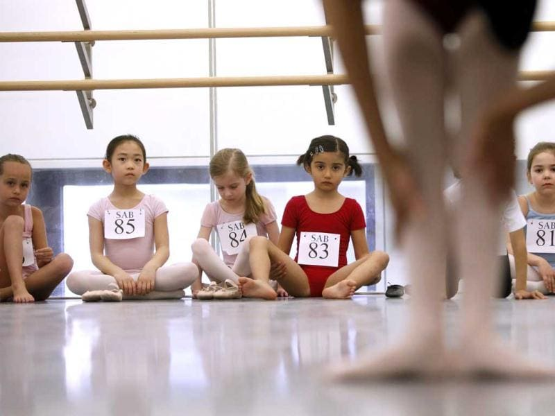 Young dancers look on as one of their peers is evaluated during an audition for six-year old ballet hopefuls at the School of American Ballet in New York. AP Photo
