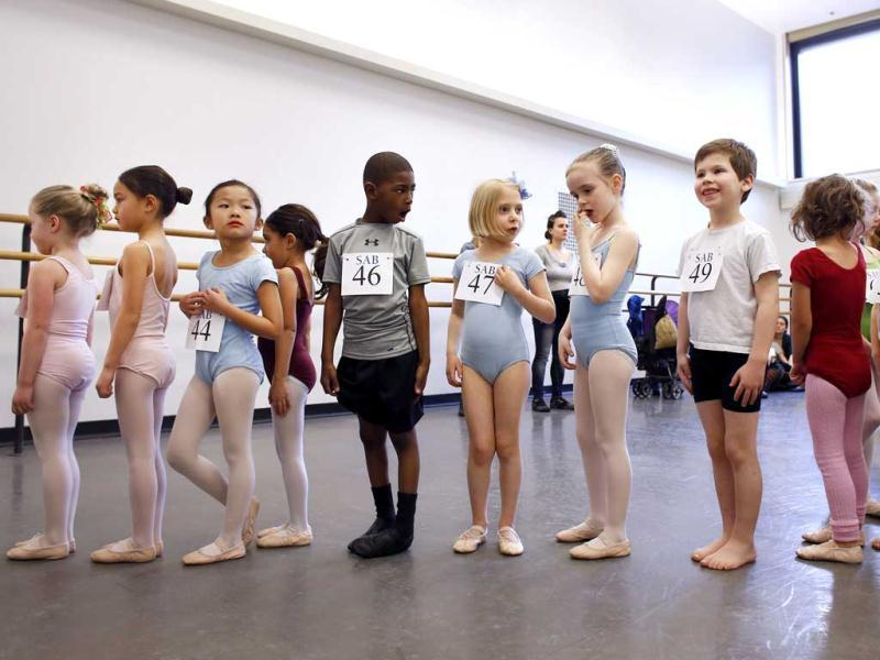 Young dancers wait to enter the studio during an audition for six-year old ballet hopefuls at the School of American Ballet in New York. AP Photo