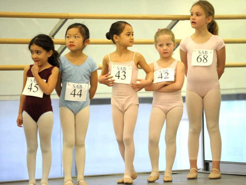 Girls wait as about 100 six-year-olds audition for spots in the School of American Ballet at Lincoln Center in New York. AFP photo