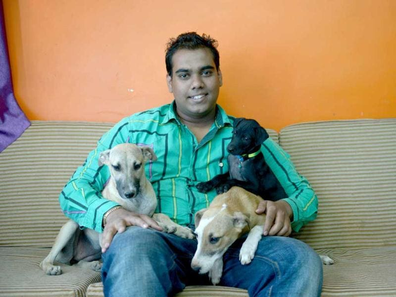 """I can probably live without food and water for a few days but I cannot live without the love of animals,"" says 24-year-old Shrikant Raskar and a proud parent of 10 cats. They all live, stretch, purr and prowl around his two bedroom flat and Raskar has rescued all of them. Raskar has also rescued dogs, cows, donkeys and birds. (Photo: Bachchan Kumar)"
