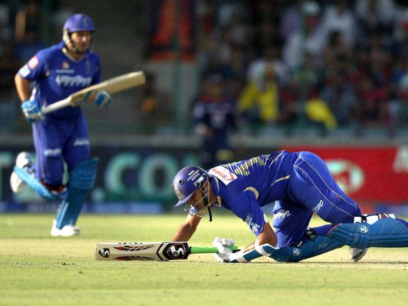 Rajasthan Royals' batsman Rahul Dravid falls while playing a shot during the IPL match against Delhi Daredevils in New Delhi. (PTI Photo)