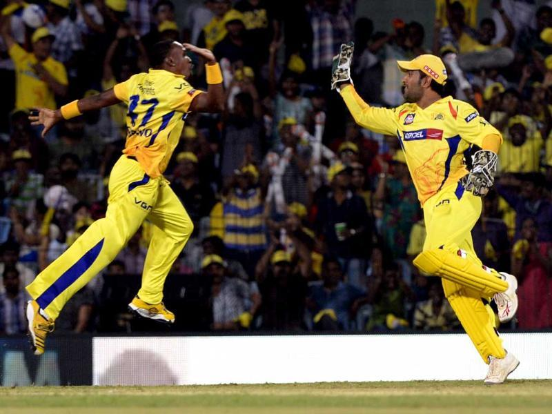 Chennai Super Kings players Dwayne Bravo and MS Dhoni celebrate the wicket of Mumbai Indians batsman Rohit Sharma during their IPL 2013 cricket match in Chennai. HT/Mohd Zakir