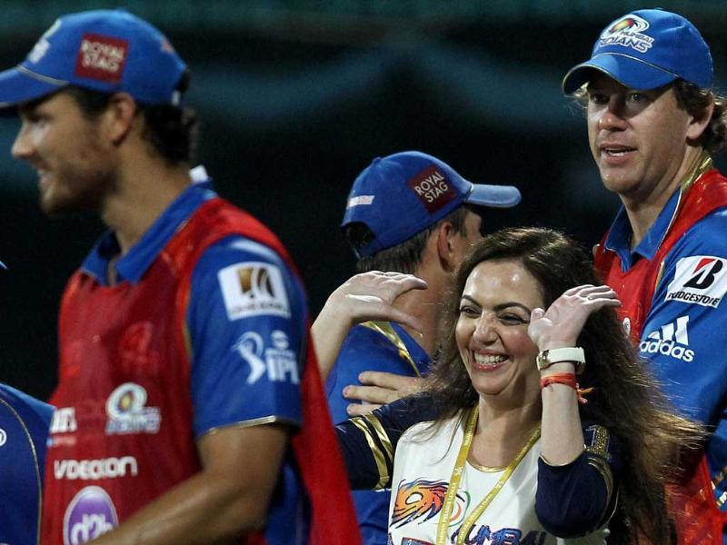 Mumbai Indians owner Nita Ambani celebrates with her team members after victory over Chennai Super Kings during the IPL T20 match at MA Chidambaram Stadium in Chennai. PTI