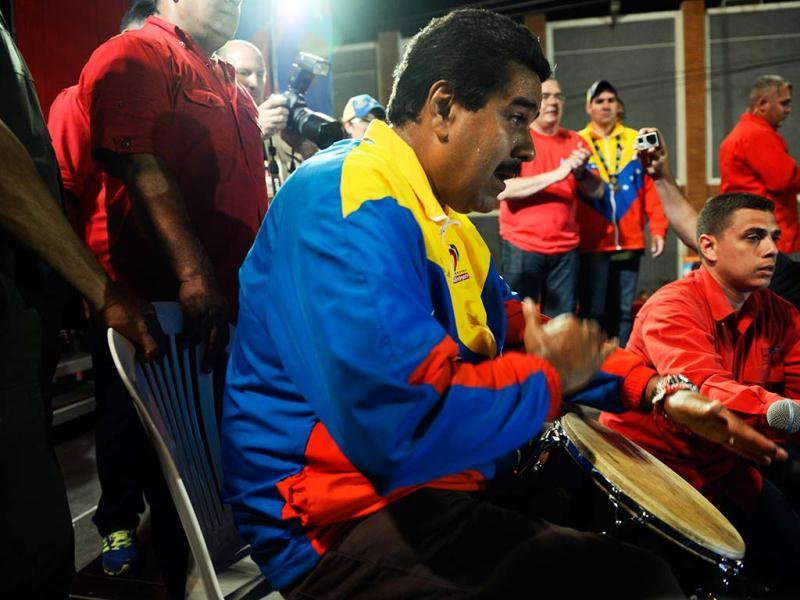 Venezuelan acting President Nicolas Maduro plays a musical instrument during a campaign rally in Puerto Ordaz, Bolivar state, Venezuela. AFP