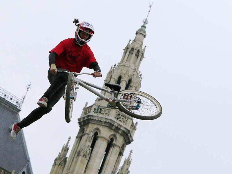 A participant practices during Red Bull's Vienna Air King dirt jumping competition held in front of the Rathaus (townhall) in Vienna. AFP