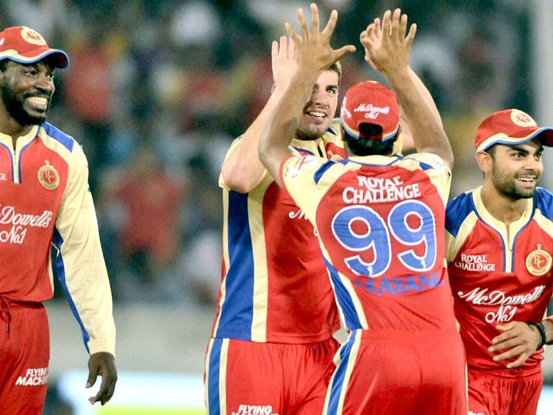 RCB's cricketers celebrate the wicket of batsman CL White of Sunrisers Hyderabad during IPL match in Hyderabad. PTI Photo
