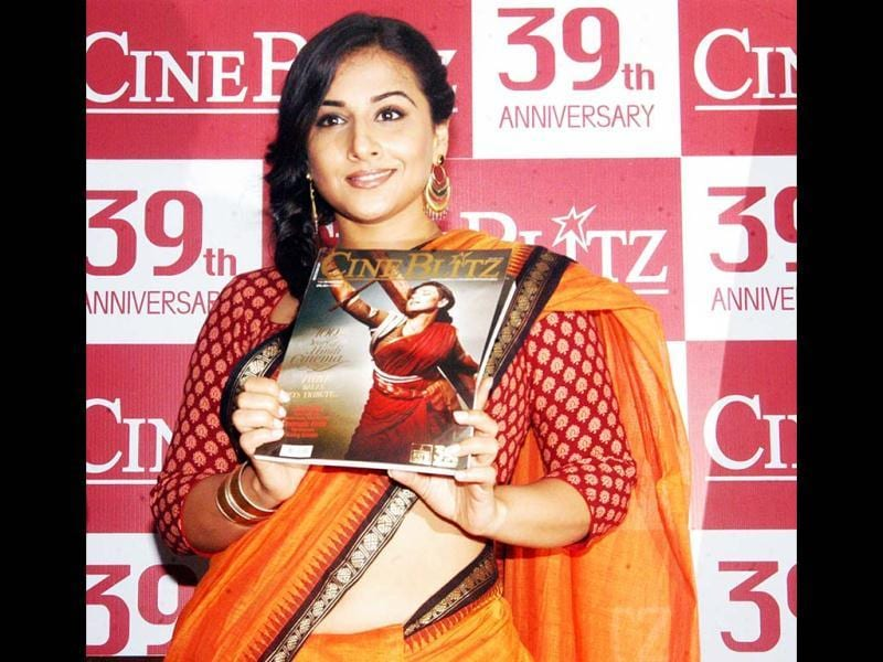 Vidya Balan poses with the magazine during the event. UNI Photo