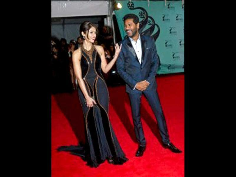 Ileana D'Cruz & Prabhu Deva share a light moment on the red carpet. (Photo Courtesy: Facebook/TOIFA)