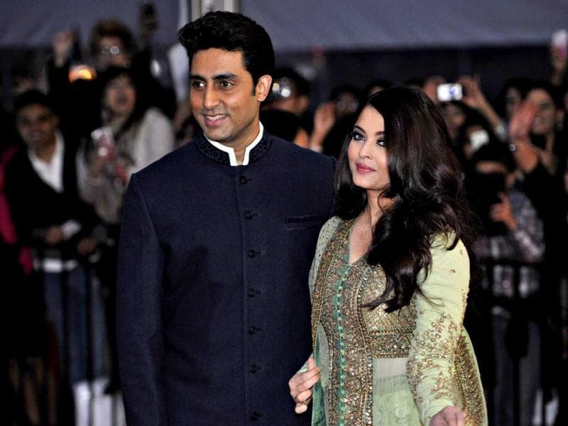Abhishek Bachchan arrives with his wife Aishwarya Rai for an award ceremony in Vancouver, on April 6, 2013. (Reuters Photo)
