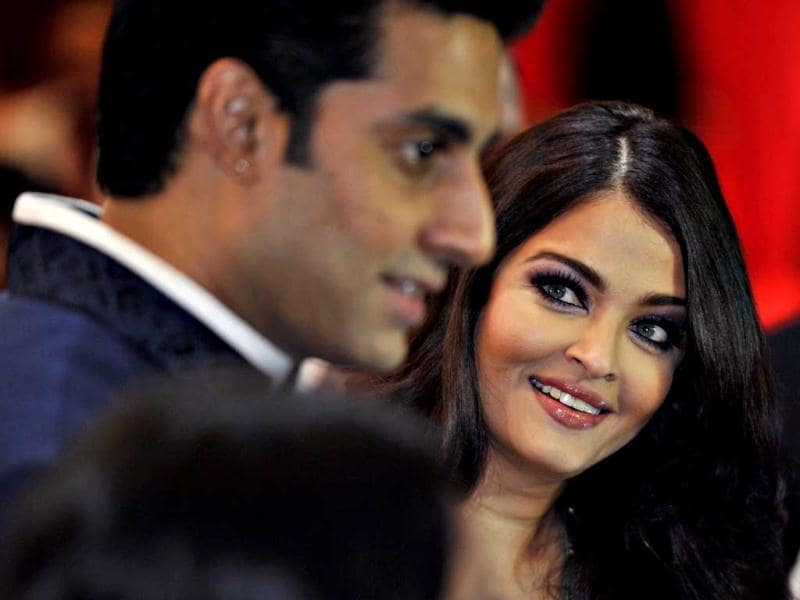 Aishwarya Rai Bachchan caught giving admiring looks to hubby Abhishek Bachchan as the couple arrives in Vancouver for an award function. (Reuters Photo)