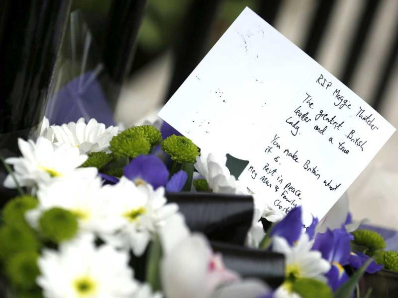 A note and floral tribute is seen after it was placed outside the home of former British prime minister Margaret Thatcher after her death was announced in London. Margaret Thatcher, the