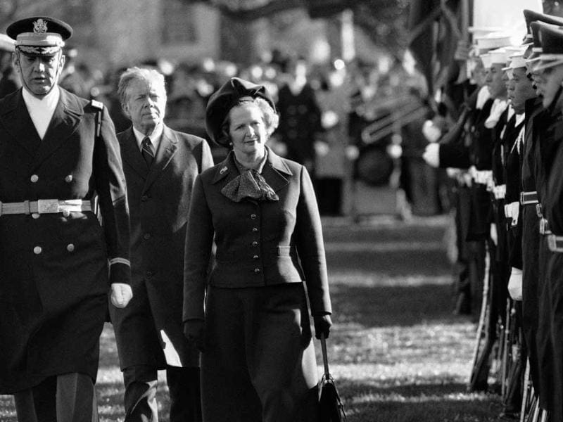 Former British prime minister Margaret Thatcher reviews the honor guard at the White House in Washington, as President Jimmy Carter follows. AP