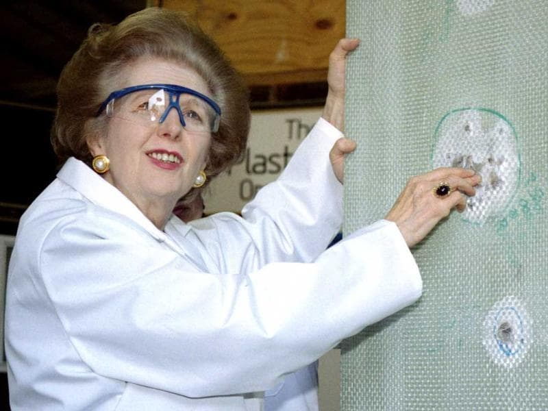 Baroness Margaret Thatcher examines a sheet of bullet-proof material during a visit to a factory producing ballistic and blast protection products. Reuters