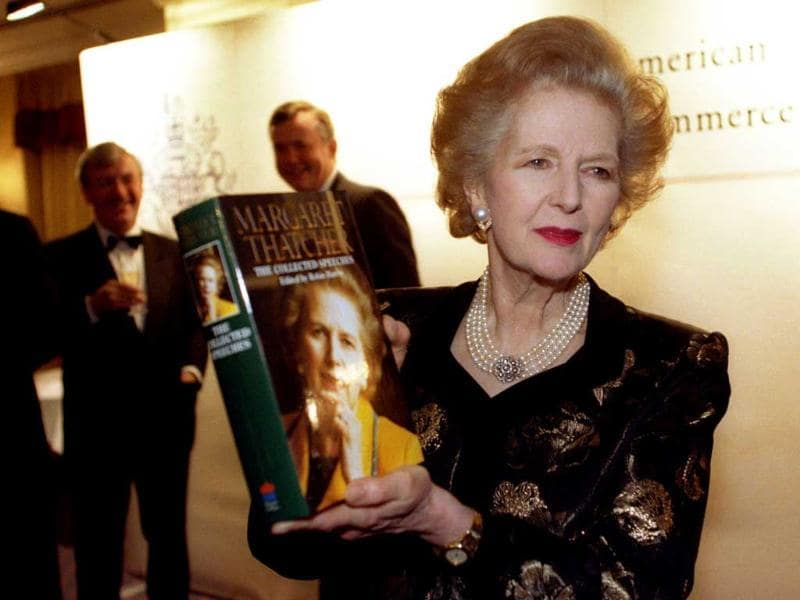 File photo of baroness Margaret Thatcher posing with a copy of her new book at a launch attended by members of the British-American Chamber of Commerce. Reuters