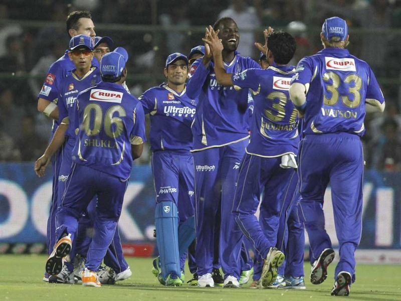 Rajasthan Royals players celebrate after the fall of a Kolkata Knight Riders' wicket during the IPL T20 match played at the Sawai Mansingh Stadium, in Jaipur. HT Photo/Sunil Saxena