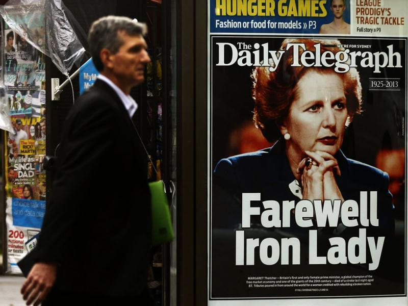 A man walks in front of a news stand with the portrait of former British prime minister Margaret Thatcher in Sydney. (Reuters)