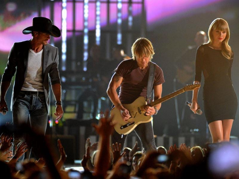 From left, Tim McGraw, Keith Urban and Taylor Swift perform at ACM Presents: Tim McGraw's Superstar Summer Night at the MGM Grand Garden Arena in Las Vegas. (AP Photo)