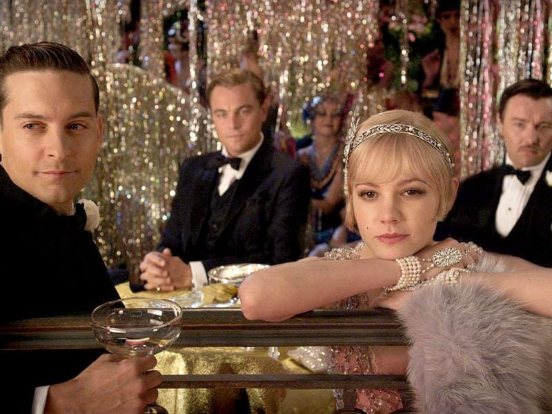 Tobey Maguire (front left), Carey Mulligan (front right), Joel Edgarton (back right) and Leonardo DiCaprio (back left) in a still from Baz Luhrmann's The Great Gatsby.