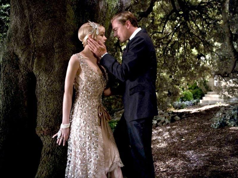 Daisy (left), who's married to the philandering, blue-blooded husband Tom Buchanan (Joel Edgerton) but has an affair with Gatsby (left).
