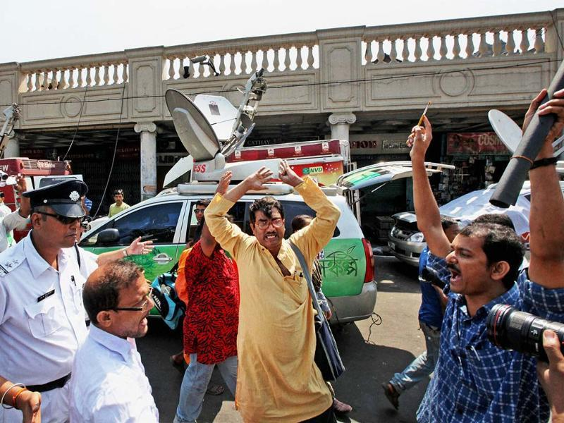 Police in action against members of a non political organisation who were holding a protest in Kolkata on Tuesday before arrival of Gujarat Chief Minister Narendra Modi.(PTI)