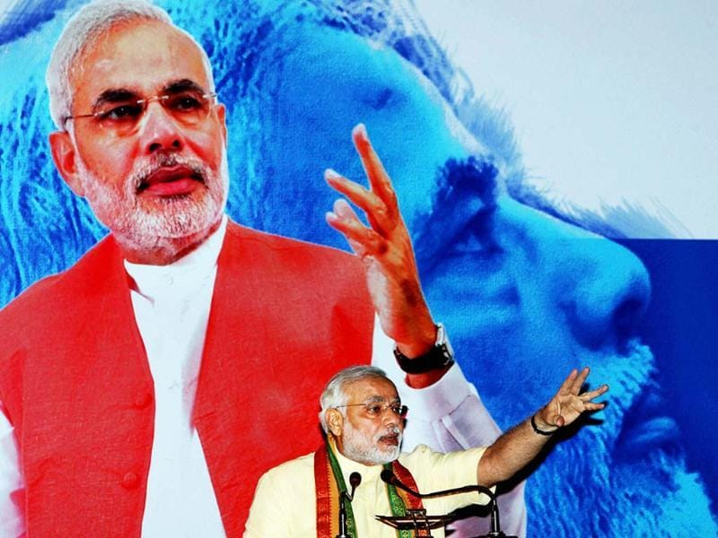 Narendra Modi speaks during a special session on 'Vibrant Growth Model' in Kolkata on Tuesday. (PTI)