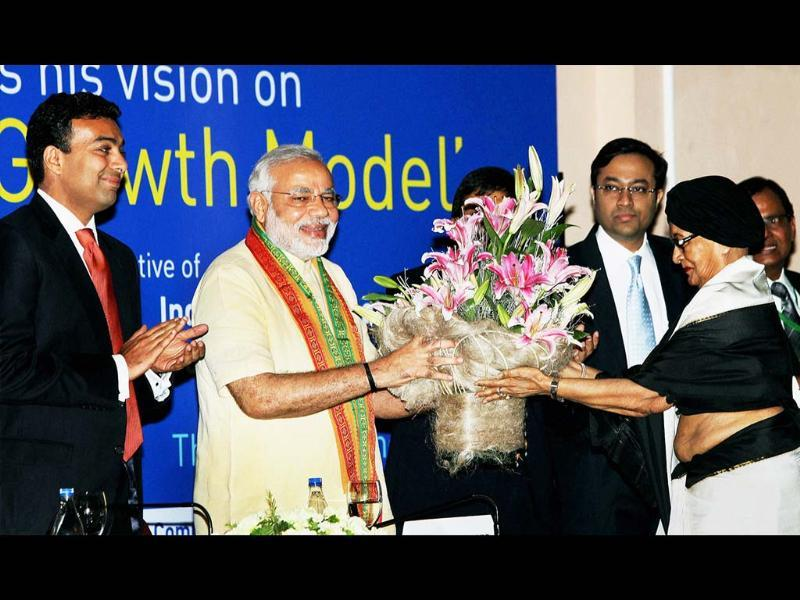 Gujarat chief minister Narendra Modi being welcomed with a floral bouquet during a special session on 'Vibrant Growth Model' in Kolkata on Tuesday. (PTI)