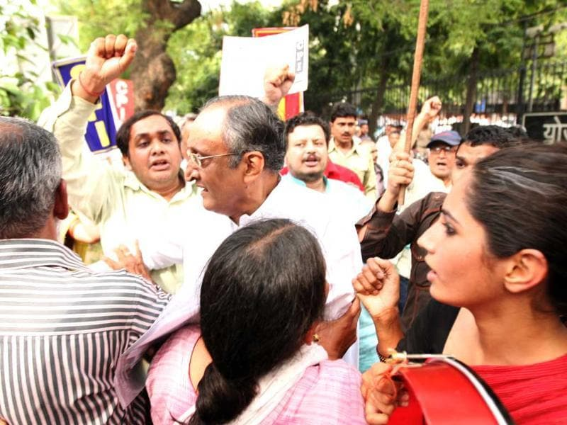 West Bengal finance minister Amit Mitra was heckled and had his shirt torn off by Students Federation of India activists outside the planning commission in New Delhi. HT