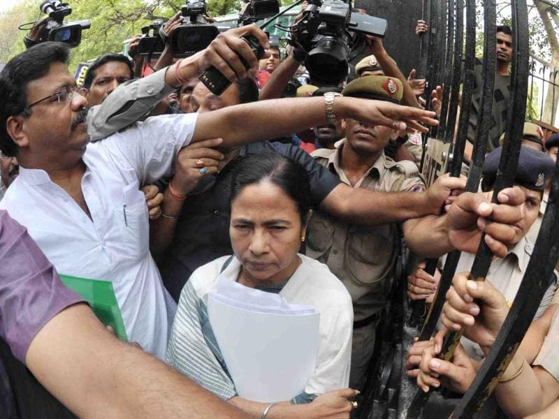 West Bengal chief minister Mamata Banerjee being escorted to planning commission office to attend the meeting with Montek Singh Ahluwalia for finalising the annual plan of the state in New Delhi. UNI